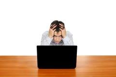Hombre joven con la computadora portátil Fotos de archivo