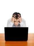 Hombre joven con la computadora portátil Imagen de archivo libre de regalías