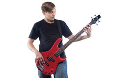 Hombre joven con la guitarra baja Imagenes de archivo
