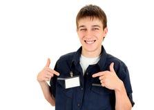 Hombre joven con la insignia en blanco Imagen de archivo libre de regalías