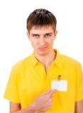 Hombre joven con la insignia vacía Imagenes de archivo
