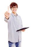 Hombre joven con la PC de la tablilla que muestra el índice Imagen de archivo