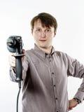 Hombre joven con la perforadora eléctrica aislada en blanco Imágenes de archivo libres de regalías