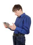Hombre joven con la tableta Fotos de archivo