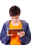 Hombre joven con la tablilla Fotografía de archivo libre de regalías
