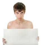 Hombre joven con la tarjeta en blanco Imagen de archivo