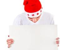 Hombre joven con la tarjeta en blanco Foto de archivo libre de regalías