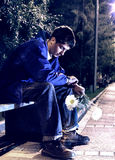 Hombre joven con las flores Foto de archivo libre de regalías