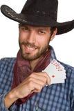 Hombre joven con las jugar-tarjetas. Foto de archivo