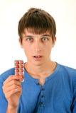 Hombre joven con las píldoras Imagenes de archivo