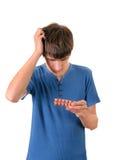 Hombre joven con las píldoras Foto de archivo libre de regalías