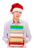 Hombre joven con libros Foto de archivo libre de regalías