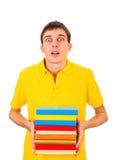 Hombre joven con libros Imagenes de archivo