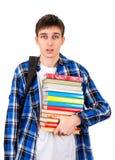 Hombre joven con libros Imágenes de archivo libres de regalías
