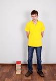 Hombre joven con libros Fotografía de archivo libre de regalías