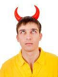 Hombre joven con los cuernos del diablo Fotos de archivo