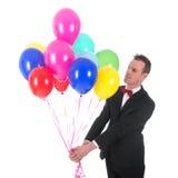 Hombre joven con los globos Fotos de archivo libres de regalías
