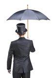 Hombre joven con los guantes que sostienen un paraguas Fotos de archivo