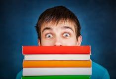 Hombre joven con los libros Imágenes de archivo libres de regalías