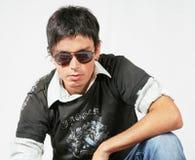 Hombre joven con los vidrios Imágenes de archivo libres de regalías