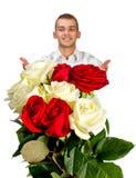 Hombre joven con Rose Imágenes de archivo libres de regalías