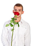 Hombre joven con Rose Fotografía de archivo