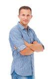 Hombre joven con sus brazos doblados Foto de archivo libre de regalías