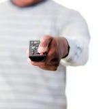 Hombre joven con teledirigido Foto de archivo libre de regalías