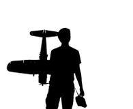 Hombre joven con un aeroplano de RC y un regulador fotografía de archivo