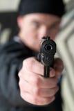 Hombre joven con un arma Imágenes de archivo libres de regalías