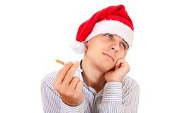 Hombre joven con un cigarrillo Imagen de archivo libre de regalías