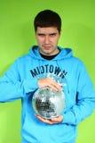 Hombre joven con un discoball Foto de archivo libre de regalías