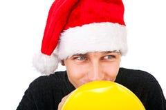 Hombre joven con un globo Fotos de archivo libres de regalías