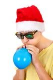 Hombre joven con un globo Imágenes de archivo libres de regalías