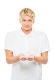 Hombre joven con un objeto imaginario aislado en blanco Imagen de archivo libre de regalías