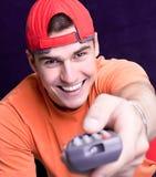 Hombre joven con un teledirigido Imagen de archivo libre de regalías