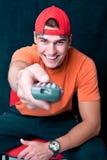 Hombre joven con un teledirigido Fotografía de archivo