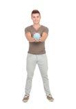 Hombre joven con una caja de dinero Fotos de archivo libres de regalías