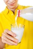 Hombre joven con una leche Foto de archivo libre de regalías