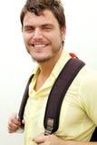 Hombre joven con una mochila Foto de archivo libre de regalías