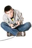 Hombre joven con una palanca de mando Imágenes de archivo libres de regalías
