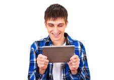 Hombre joven con una tableta Fotografía de archivo