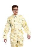 Hombre joven con vidrios cubiertos con las notas pegajosas amarillas Imagen de archivo