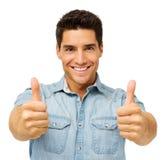 Hombre joven confiado que gesticula los pulgares para arriba fotografía de archivo libre de regalías