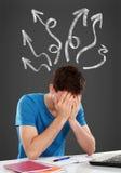 Hombre joven confuso que cubre su cabeza Imagen de archivo libre de regalías