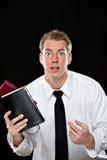 Hombre joven confuso que sostiene las biblias Fotografía de archivo