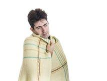 Hombre joven de bostezo con la tela escocesa envuelta Foto de archivo libre de regalías