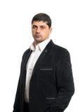Hombre joven de la moda en chaqueta negra Fotos de archivo