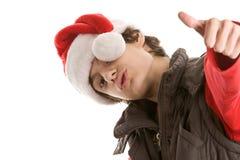 Hombre joven de la Navidad con los pulgares para arriba Imagenes de archivo