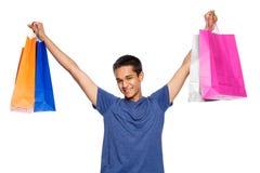 Hombre joven de la raza mixta con los panieres coloridos Foto de archivo libre de regalías